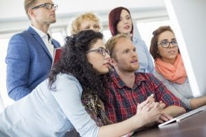 Business people watching soft skills videos