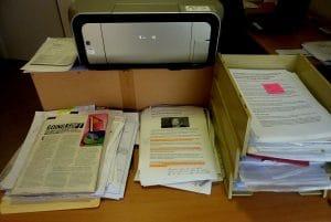 Unorganised papers on desk