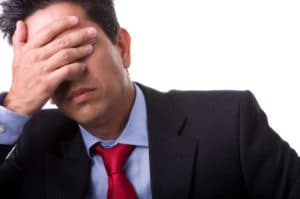 businessman with a big headache (isolated on with with copyspace)